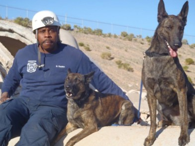 Shawn Tucker with his highly trained Rescue Dogs